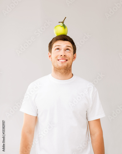 man with green apple on his head
