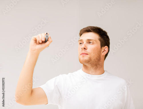 man writing something in the air