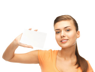 smiling woman holding white blank card
