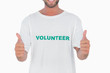Man wearing volunteer tshirt giving thumbs up
