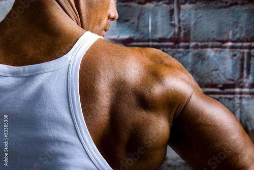 A beautiful young muscular man's shoulder