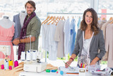 Fashion designers working and smiling at camera