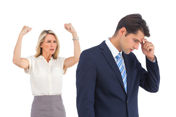 Anxious businessman and cheering businesswoman