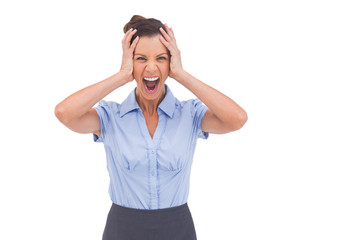 Stressed businessswoman with hand on her head