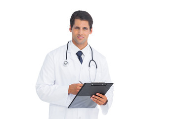Doctor holding a clipboard and pen and smiling