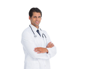 Handsome doctor smiling with arms crossed