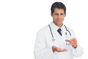 Happy doctor smiling and holding medicine