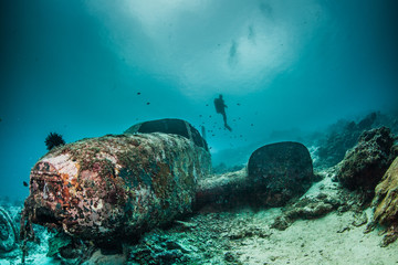 Diver and underwater plane wreck