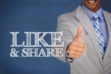 Like and share written next to a businessman