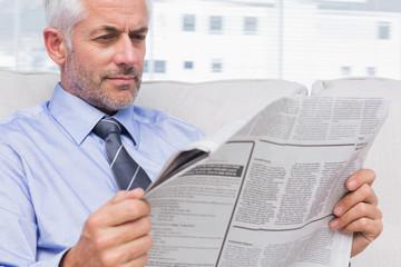 Businessman reading the news