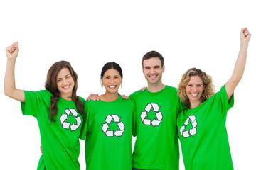 Smiling group of environmental activists raising arms