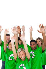 Cheerful group of environmental activists raising arms