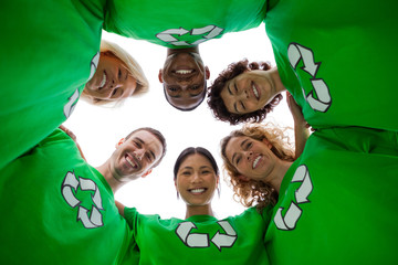 Low angle view of people wearing green shirt with recycling symb