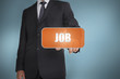 Businessman selecting orange tag with the word job written on it