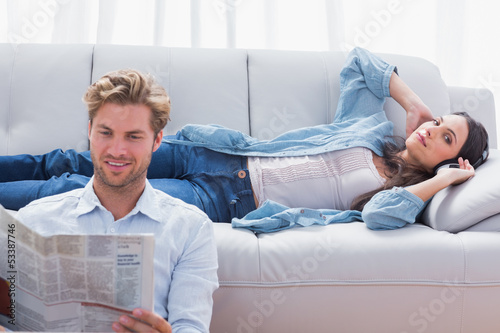 Woman relaxing on a couch listening to music
