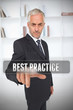 Serious businessman touching the term best practice