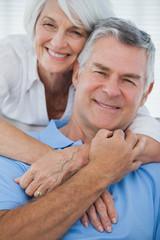 Portrait of woman embracing husband