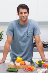 Attractive man standing in his kitchen