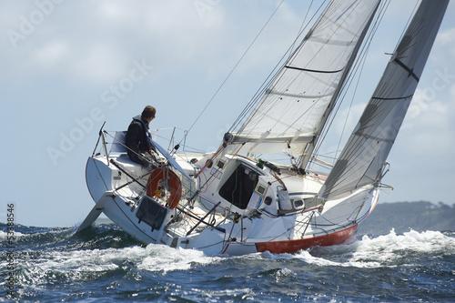 Leinwandbild Motiv skipper sur son yacht de sport