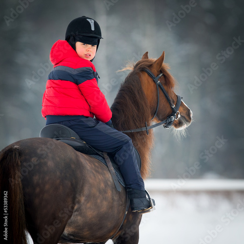 Horse and boy - riding horseback