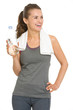 Smiling fitness woman with bottle of water looking on copy space