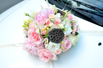 Wedding car decorated with flower bouquet