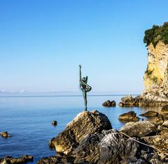 Statue of gymnast on seaside, Budva, Montenegro.