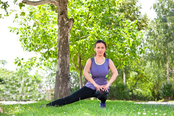 Exercise woman stretching hamstring leg muscles