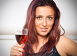 Young happy smiling cheerful beautiful woman with glass of red w