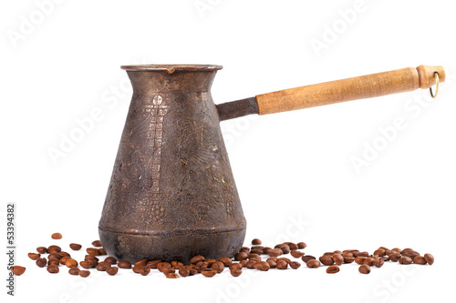 Old coffee pot with coffee beans. Isolated on white