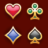 Golden card suits with gems