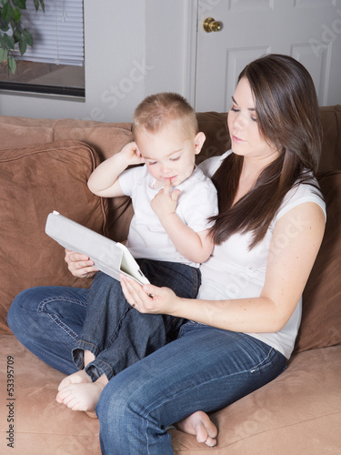 Young mother and son reading and sharing together