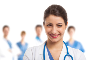 Smiling nurse in front of her team