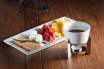 Chocolate fondue with dipping fruit and marshmallow treats