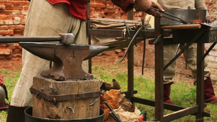 Smith makes a metal object on the historic festival
