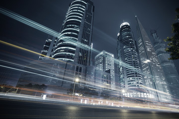 The highway car light trails of modern urban buildings