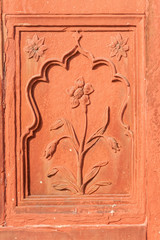 Double framed flower carved in red sandstone.