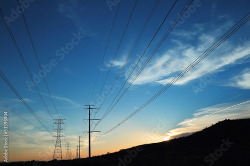 Power transmission towers at sunset