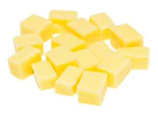 small cheese dices on white background