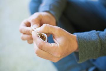 hand rolling marijuana closeup