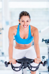 Fit woman doing spinning