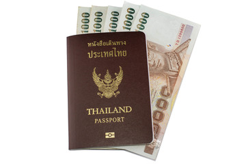 Thailand passport and Thai money on white background