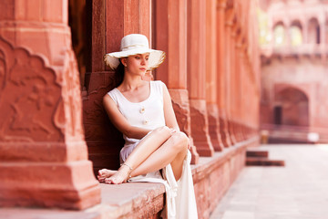 Girl sitting in Taj Mahal fortress.