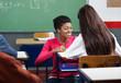 Teacher Teaching Teenage Schoolgirl At Desk