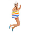 Happy young woman with beach bag jumping