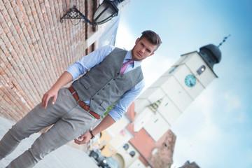 casual man walks in Sibiu city