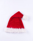 Red and white folded over Santa hat on white background