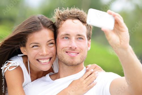Couple fun taking self-portrait picture photos