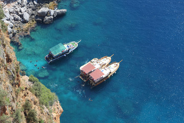 View from height of tourist boats and swimmers people