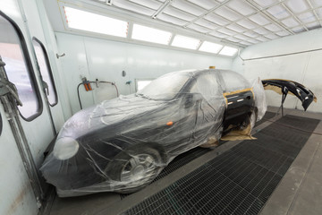 Painting the car door and bumper on body shop